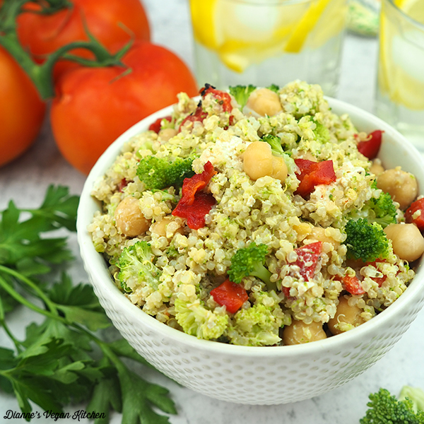 small bowl of quinoa salad with lemon water and tomatoes