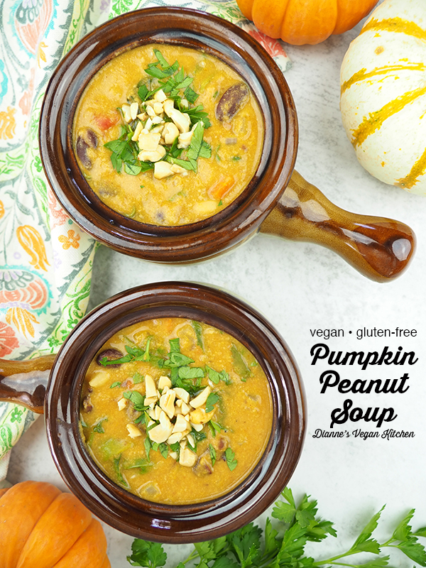Curried Pumpkin Peanut Soup in crocks overhead shot with text overlay