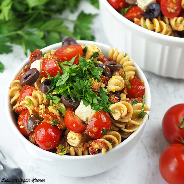 two bowls of pasta salad