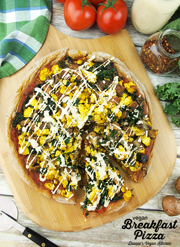 Topped with vegetables, tofu scramble, and tempeh bacon, this Vegan Breakfast Pizza is the perfect dish for weekend brunch! >> Dianne's Vegan Kitchen
