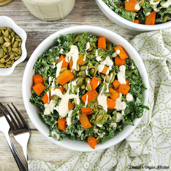 bowl of salad overhead with dressing and pumpkin seeds
