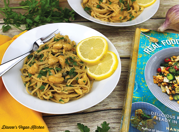 two plates of Vegan Cashew Scampi with the cookbook