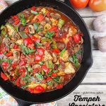 skillet of Vegan Tempeh Cacciatore with text overlay