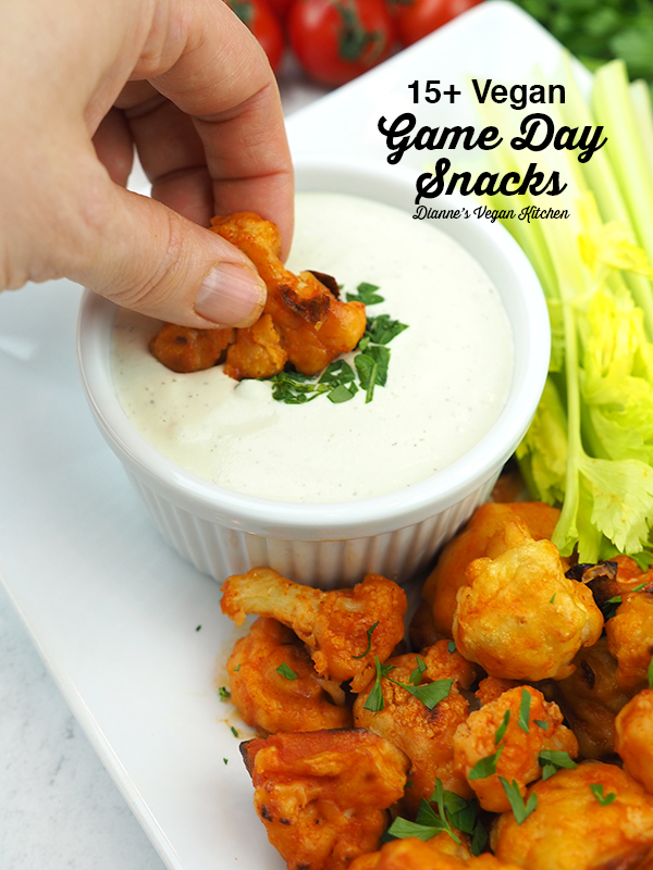 Dipping buffalo cauliflower with 15+ Vegan Game Day Snacks text overlay
