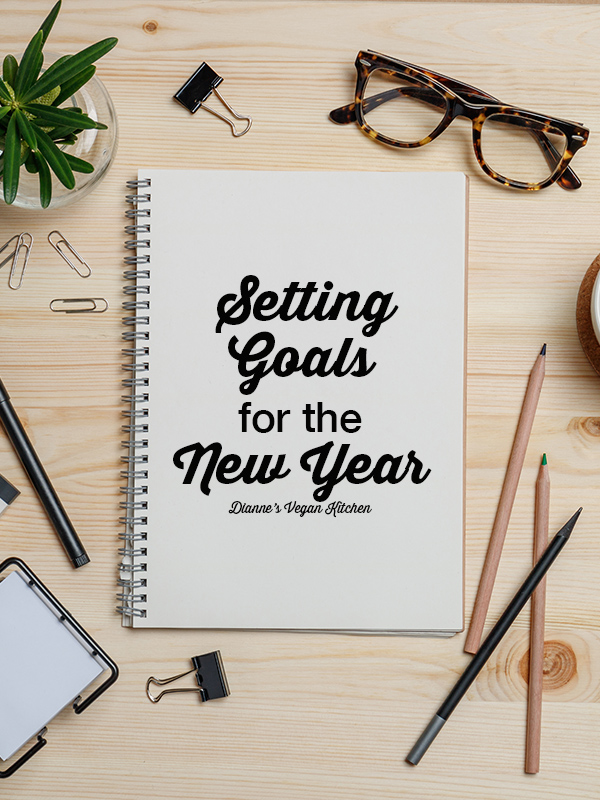 Setting Goals for the New Year notebook with text overlay