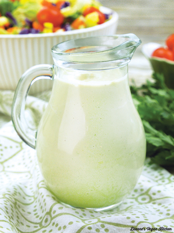 Jar of ranch dressing with salad in background