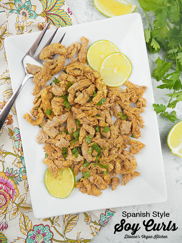 Protein rich, vegan Spanish Style Soy Curls can be baked in the oven or cooked in the air-fryer. They are a great main dish for dinner. (gluten-free option) #vegan #soycurls #vegandinner #veganprotein
