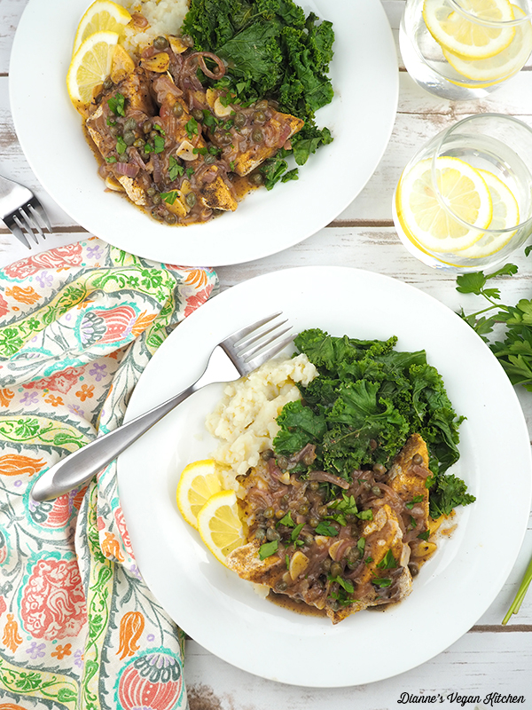 tempeh piccata on plates with mashed potatoes and kale