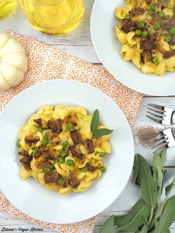 Vegan Pumpkin Pasta Carbonara in bowls from above with wine glasses