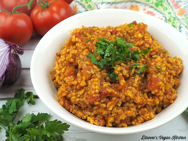 spanish rice in bowl with tomatoes and onion