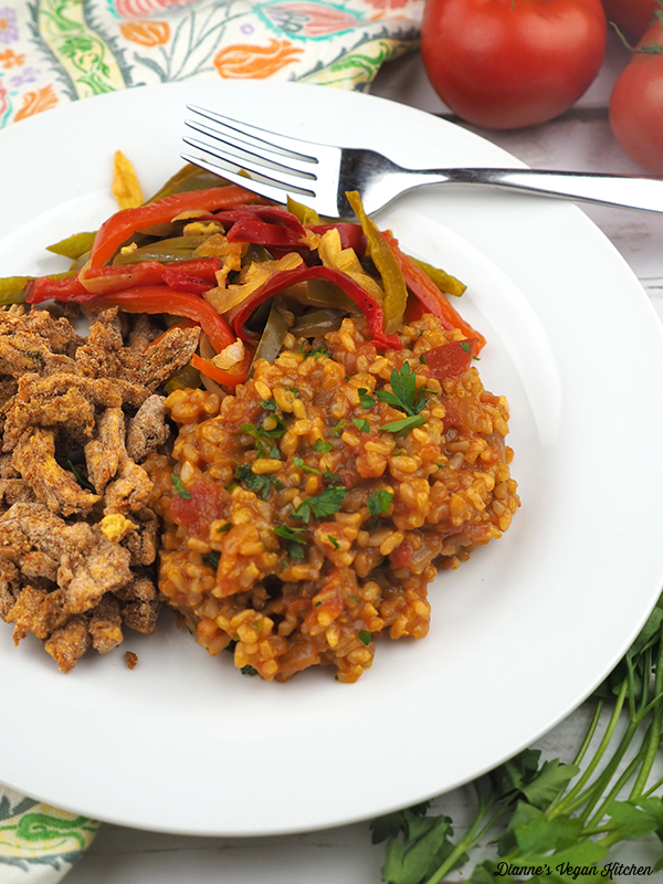 Vegan Spanish Rice on plate with peppers and soy curls