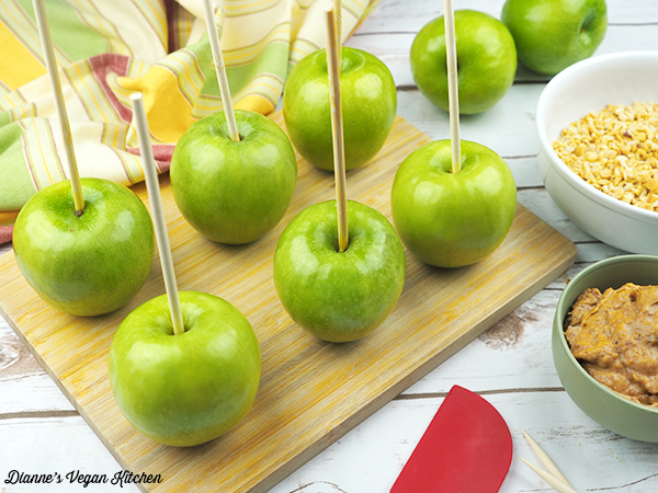 sticks in apples, about to dip in caramel sauce