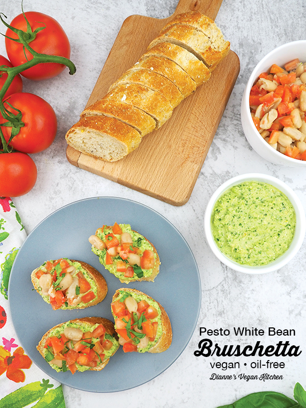 White Bean Bruschetta with bread, tomatoes, pesto, and beans