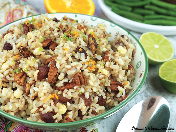 Thanksgiving Rice in bowl with oranges and limes horizontal