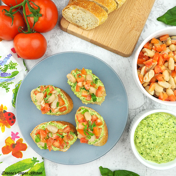 Bruschetta with bread, tomatoes, pesto, and beans from above square