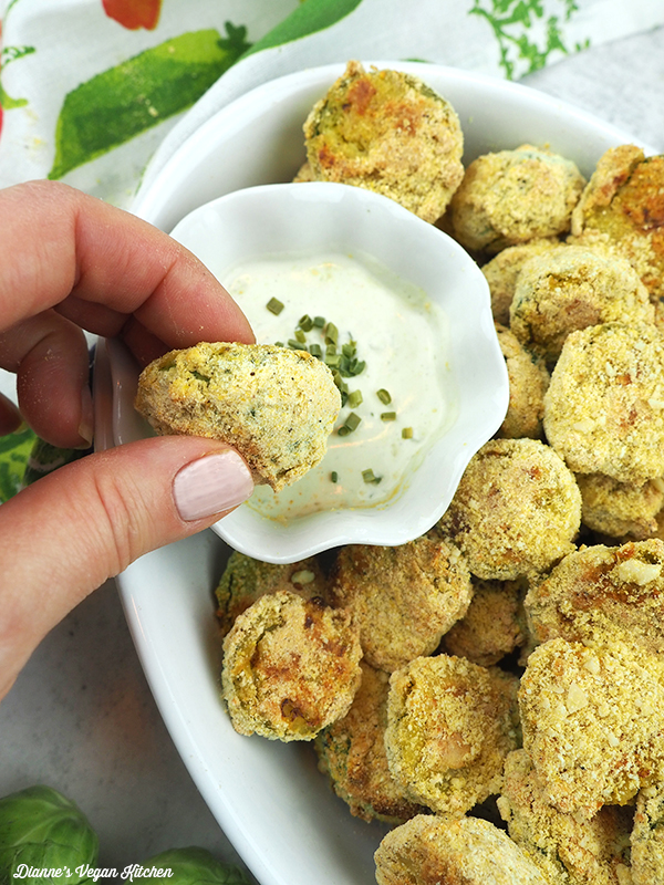 Dipping Cornmeal Crusted Brussels Sprouts in ranch dressing