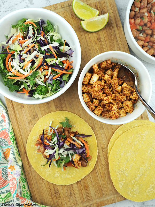 Assembling tacos with kale slaw