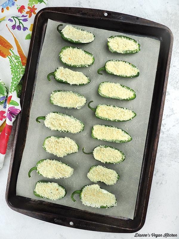 Vegan Jalapeno Poppers on baking sheet before cooking