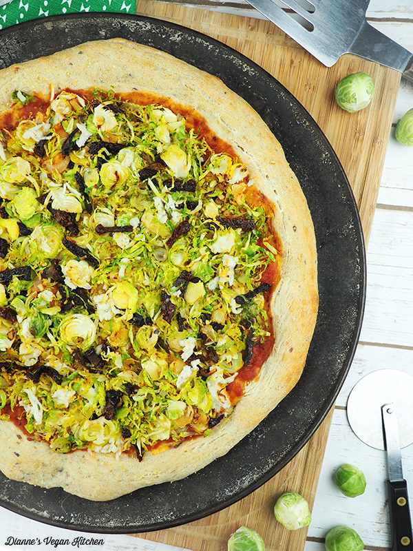 Vegan Brussels Sprouts Pizza fresh from the oven on pizza pan