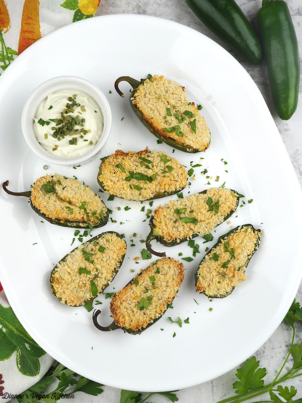 Vegan Jalapeno Poppers on serving platter with extra cheese