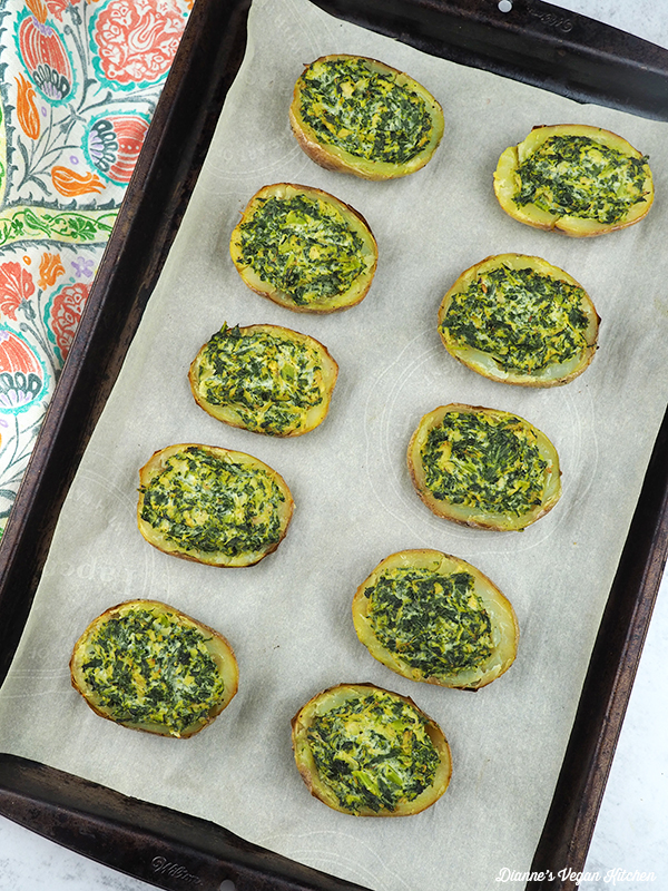 Vegan Spinach Dip Potato Skins on baking sheet