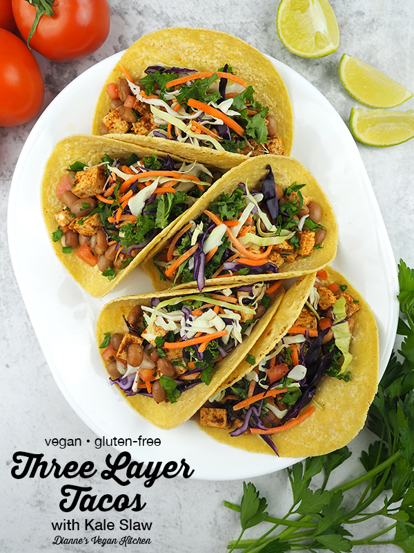 You're not going to want to wait until Taco Tuesday to make these easy-to-make Three Layer Tacos with Kale Slaw from The High Protein Vegan Cookbook by Ginny Kay McMeans. They're loaded with beans, marinated tofu, and spicy kale slaw. They're vegan and gluten-free
