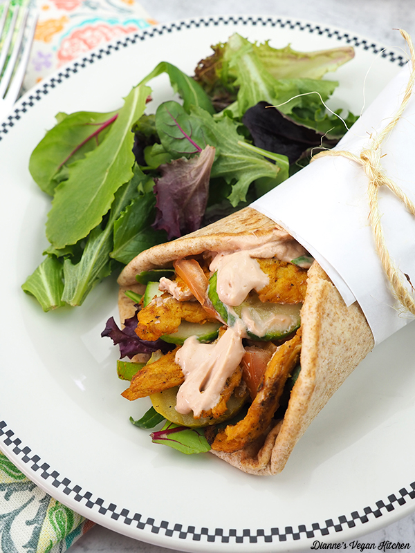 Vegan shawarma on plate with salad