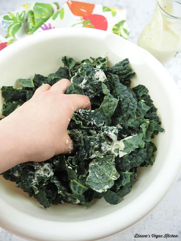 massaging kale for BLT Salad