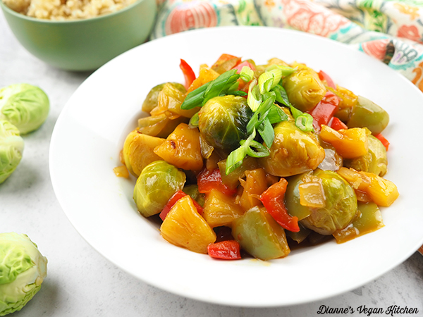 cooked sweet and sour brussels sprouts in bowls with rice horizontal