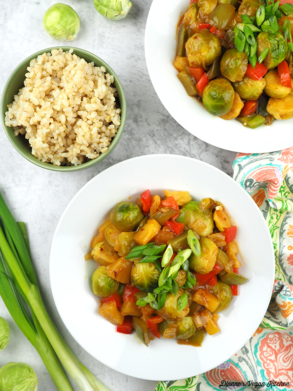 cooked sweet and sour brussels sprouts in bowls with rice from above