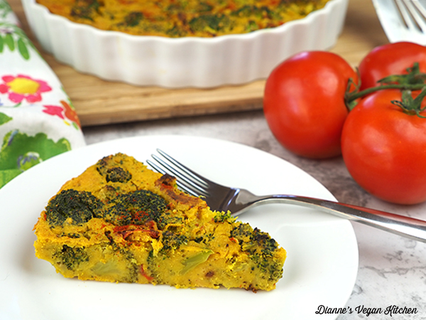 Vegan Broccoli Frittata with Sun-Dried Tomatoes slice on plate horizontal