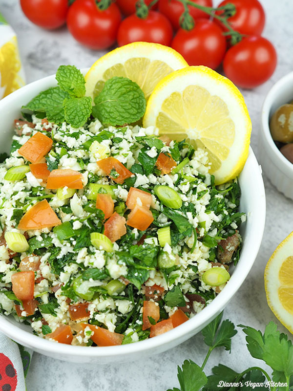 cauliflower tabbouleh in bowl with tomatoes