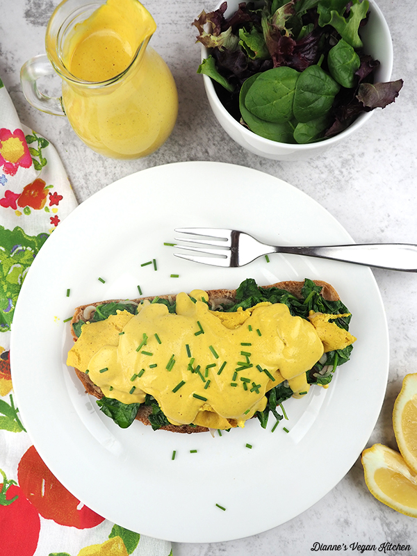 Vegan Tofu Florentine with salad and hollandaise from above