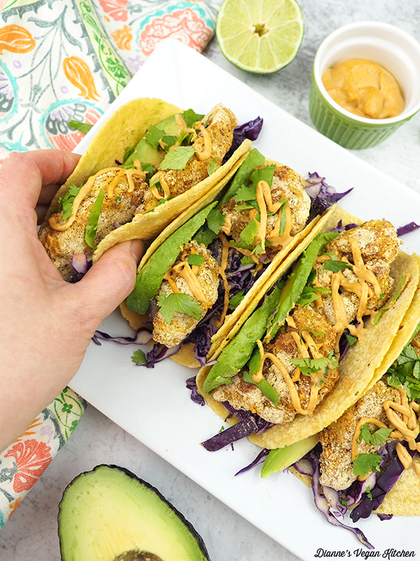 reaching for a cauliflower taco
