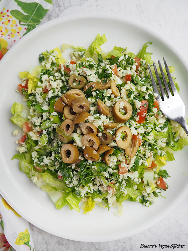 cauliflower tabbouleh salad with lettuce and olives