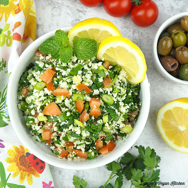 cauliflower tabbouleh overhead with tomatoes and olives