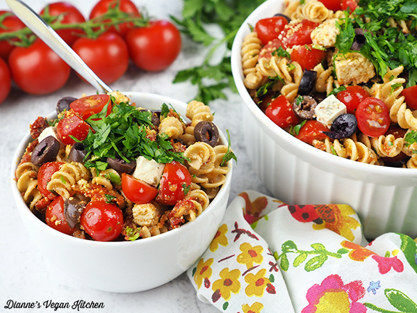 Two bowls of pasta salad horizontal