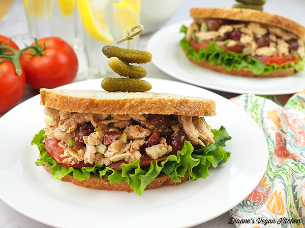 plates of vegan chicken salad sandwiches horizontal