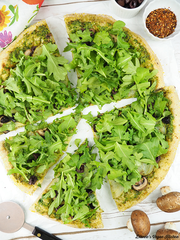 Vegan Potato, Pesto, and Arugula Pizza sliced