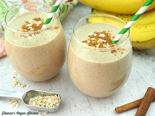 two smoothies with measuring spoon horizontal