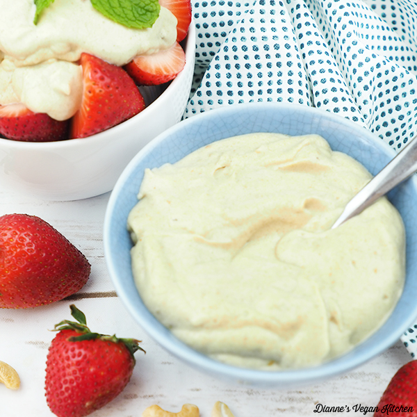 cashew cream in bowl with bowl of strawberries square