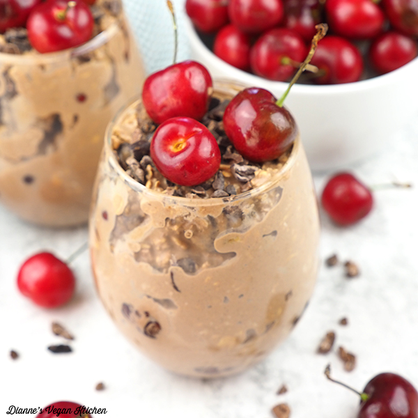 glass of overnight oats with cherries, square