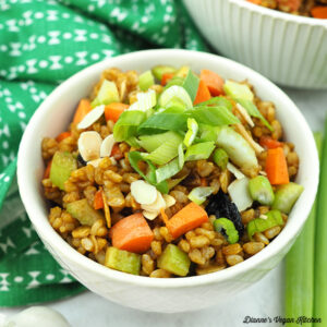Bowl of brown rice salad with green napkin