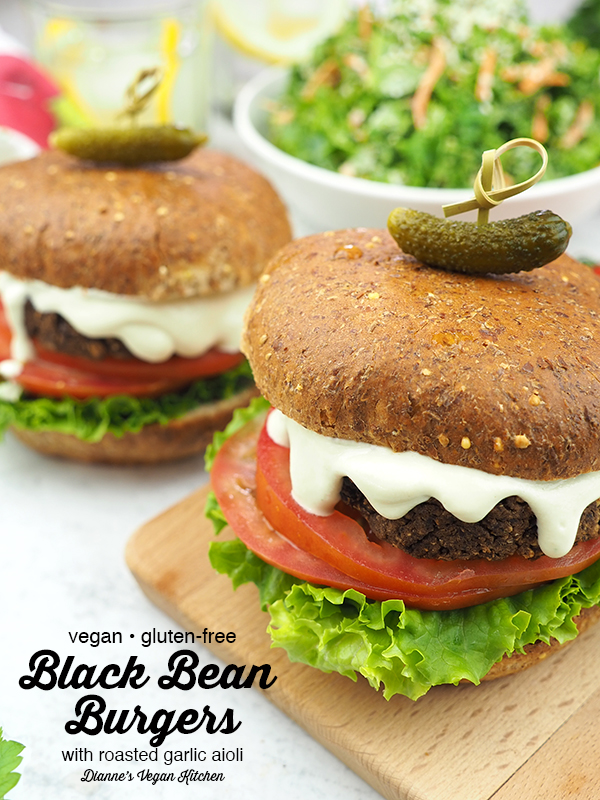two vegan black bean burgers with text overlay