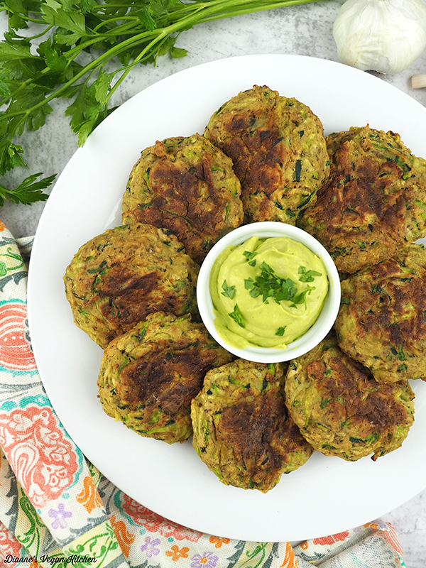 zucchini fritters with avocado cream on plate from above