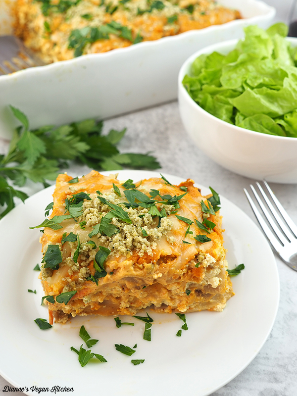 slice of lasagna with salad