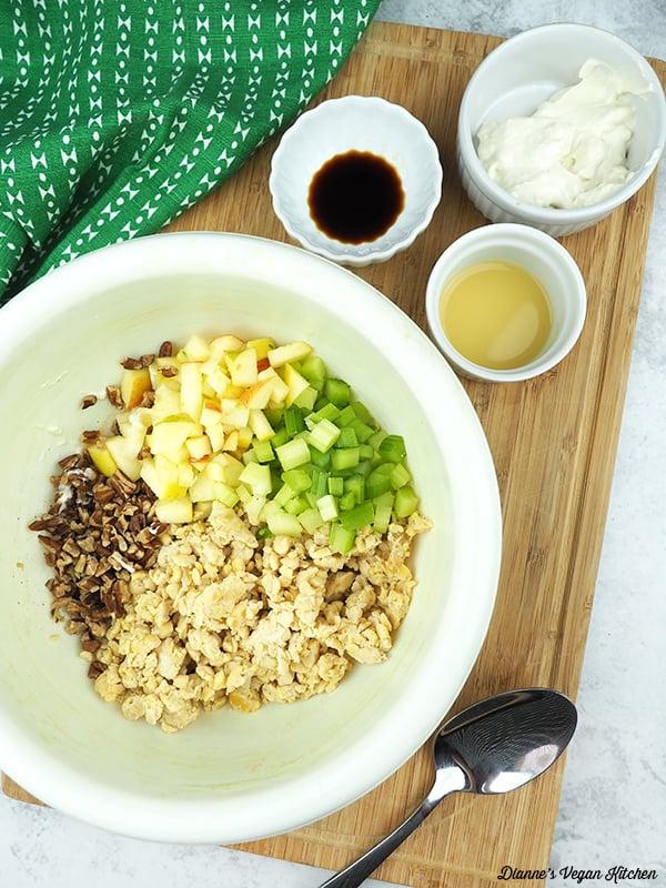 tempeh salad ingredients in mixing bowl