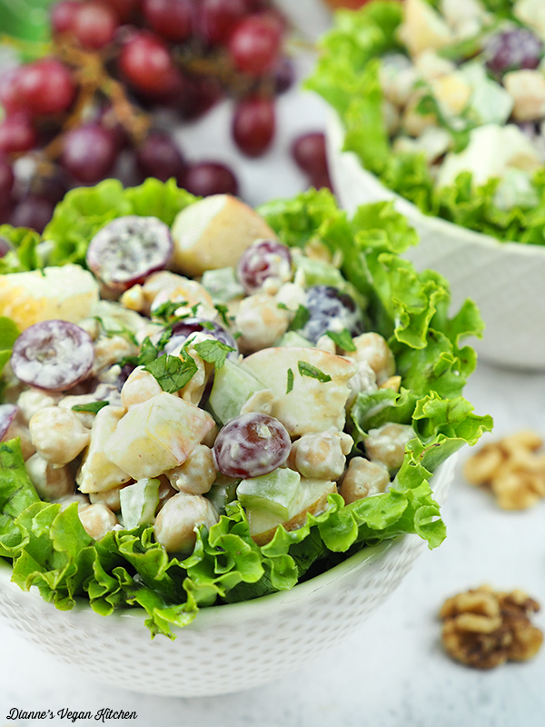 Vegan Chickpea Waldorf Salad in bowl with lettuce and grapes