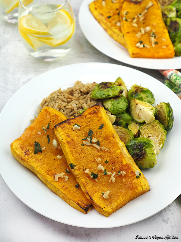 butternut squash on plates with rice and brussels sprouts