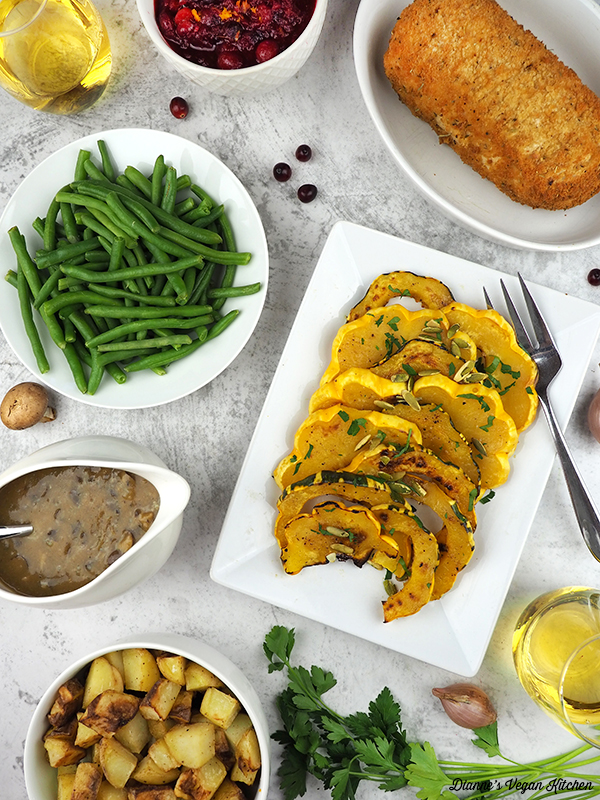 Vegan Thanksgiving recipes: squash, cranberry sauce, green beans, squash, and gravy